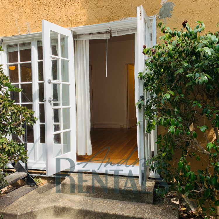 Sweet, sunny studio unit in a charming 1920's vintage building, with original matchstick floors and large french doors!